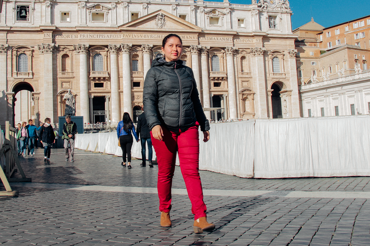 Unbound staffer Yenifer Valencia Morales walks through St. Peter's Square in Vatican City before meeting Pope Francis.